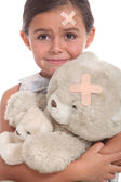 Little girl and teddy bear injured — Stock Photo