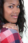 Black woman wearing checked shirt — Stock Photo