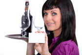 Sommelier holding up her business card — Stock Photo