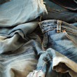 Heap of jeans — Stockfoto