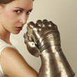 Young woman with steel glove — Stock Photo