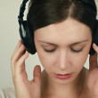 Stock Photo: Young womlistening music