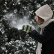 Winter woman blowing a snow — Stockfoto