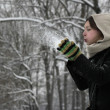 Winter woman blowing a snow — Foto Stock