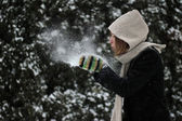 Winter woman blowing a snow — Foto de Stock