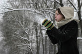 Winter woman blowing a snow — Стоковое фото