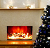 Electric fireplace with the Christmas tree — Stock Photo
