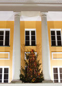 Facade of an office building with Christmas tree — Stock Photo