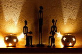 Three African figurines and tambourine — Стоковое фото