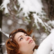 Closeup portrait of a young girl on the background of the winter — Stock Photo #8373167