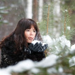 Portrait of a beautiful young girl with hands in the snow — Stock Photo #8373339
