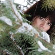 Closeup portrait of a young girl on the background of the winter — Stock Photo