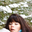 Stock Photo: Closeup portrait of young girl on background of winter