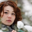 Closeup portrait of a young girl on the background of the winter — Stock Photo #8373447