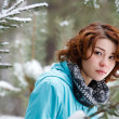 Stock Photo: Portrait of young girl on background of winter forest