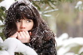 Portrait of a young girl with the snow in her hair — Stock Photo