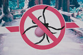 Placard with the sign of a tick bite dangers — Stock Photo