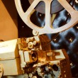 Antique gold color projector with the film — Foto de stock #9701855