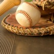 Baseball Bat and Glove in the Dugout — Lizenzfreies Foto