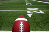 Football close up with the Field Beyond — Stock Photo