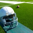 American Football Helmet on the Bench - Foto Stock