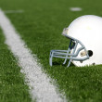 American Football Helmet on Field — Stock Photo #8950680