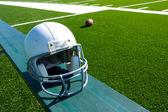 American Football Helmet on the Bench — Stock Photo