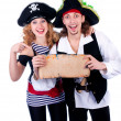Stock Photo: Two pirate man and a woman holding a map in his hands