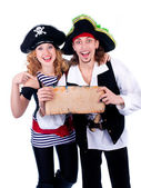 Two pirate man and a woman holding a map in his hands — Stock Photo