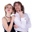 A man and a woman in a black and white clothes look away — Stock Photo