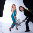 Male and female models in a photographic studio - Stock Photo