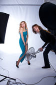 Male and female models in a photographic studio — Stock Photo