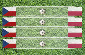 Plasticine Football flag on grass background for score (Group A) — Stock Photo