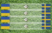 Plasticine Football flag on grass background for score (Group D) — Stock Photo