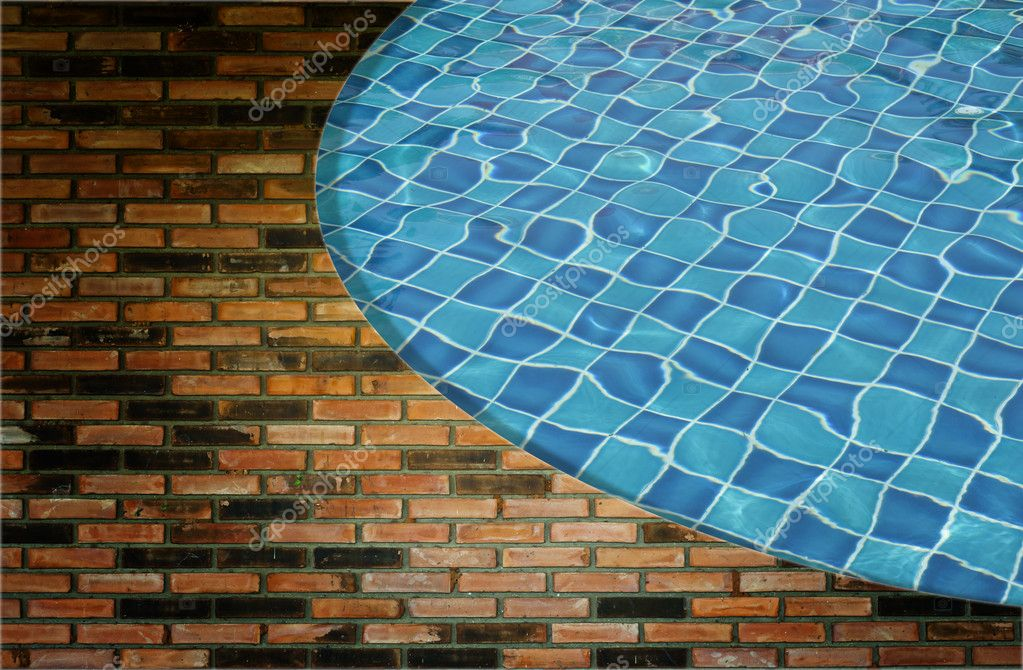 Blue wave water in Swimming pool and wall background — Stock Photo #9766800