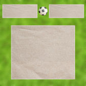 Plasticine Football on Leafs and paper , Frame background — Stock Photo