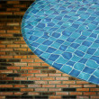 Royalty-Free Stock Photo: Blue wave water in Swimming pool and wall background