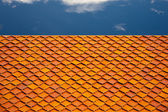 Red roof and cloudy sky background — Stok fotoğraf