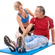 Senior man doing fitness exercise - Stock Photo