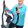 Senior woman exercising on stepper — Stock Photo