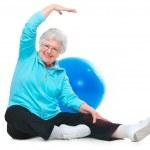 Senior woman doing stretching exercises — Stock Photo