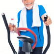 Senior man exercising on stepper - Stock Photo