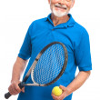 Senior man with a tennis racket — Stock Photo #10073298
