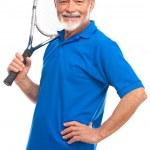 Senior man with a tennis racket — Stock Photo