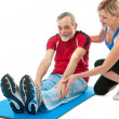 Senior man doing fitness exercise — Stock Photo