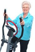 Senior woman exercising on stepper — Stock Photo