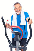 Senior man exercising on stepper — Stock Photo