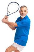 Senior man playing tennis — Stock Photo