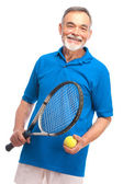 Senior man with a tennis racket — Stock Photo