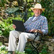 Senior with a laptop — Stock Photo #10535178